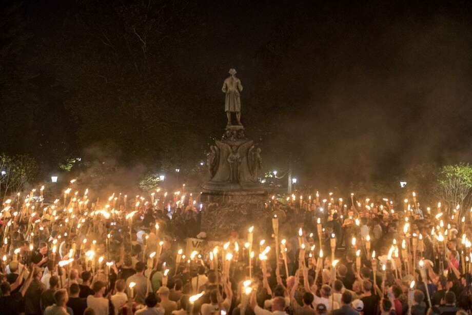 Torch-bearing white nationalists rally near the University of Virginia campus in Charlottesville Saturday. Following violent confrontations on Saturday, a car plowed into a crowd of counterprotesters, killing one and injuring at least 19. Photo: EDU BAYER / NYT / NYTNS