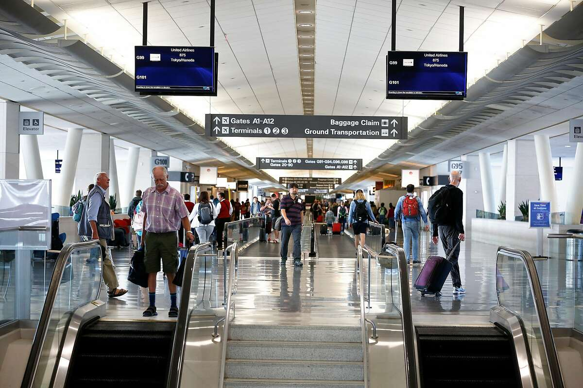 View of commuters at the gate area of the International terminal of San Francisco International Airport on Thursday, July 20, 2017 in San Francisco, Calif.