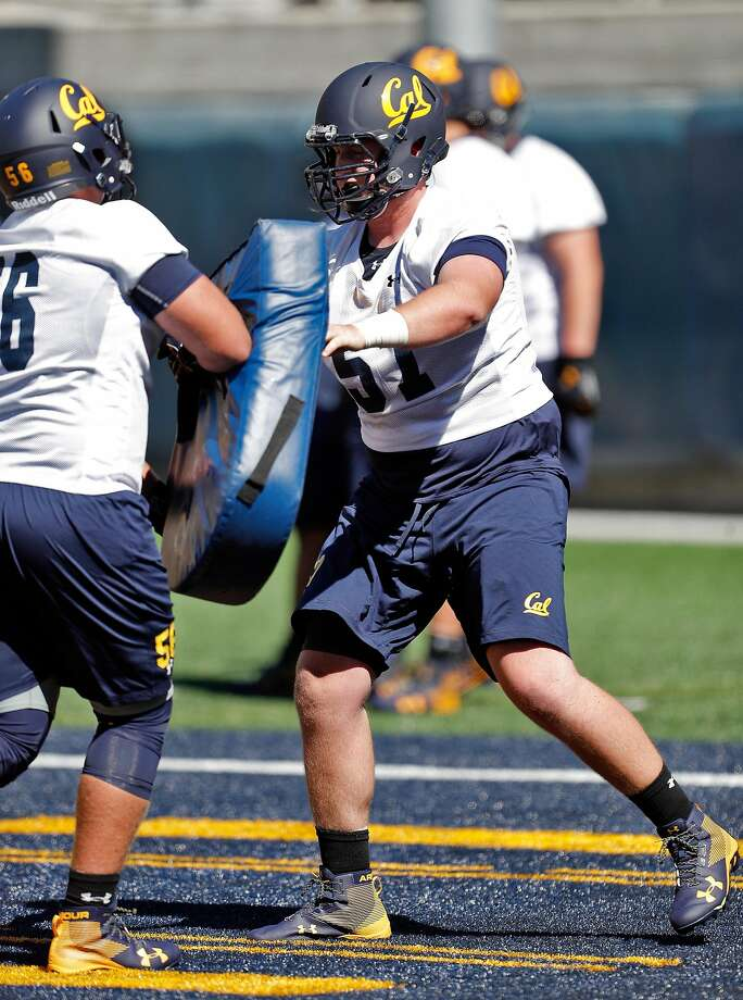 Cal Bears Addison Ooms (57), right, pushes Jack Beeman (56) during an offense work out during Cal football practice at Memorial Stadium in Berkeley, Calif., on Monday, July 31, 2017. Photo: Carlos Avila Gonzalez, The Chronicle