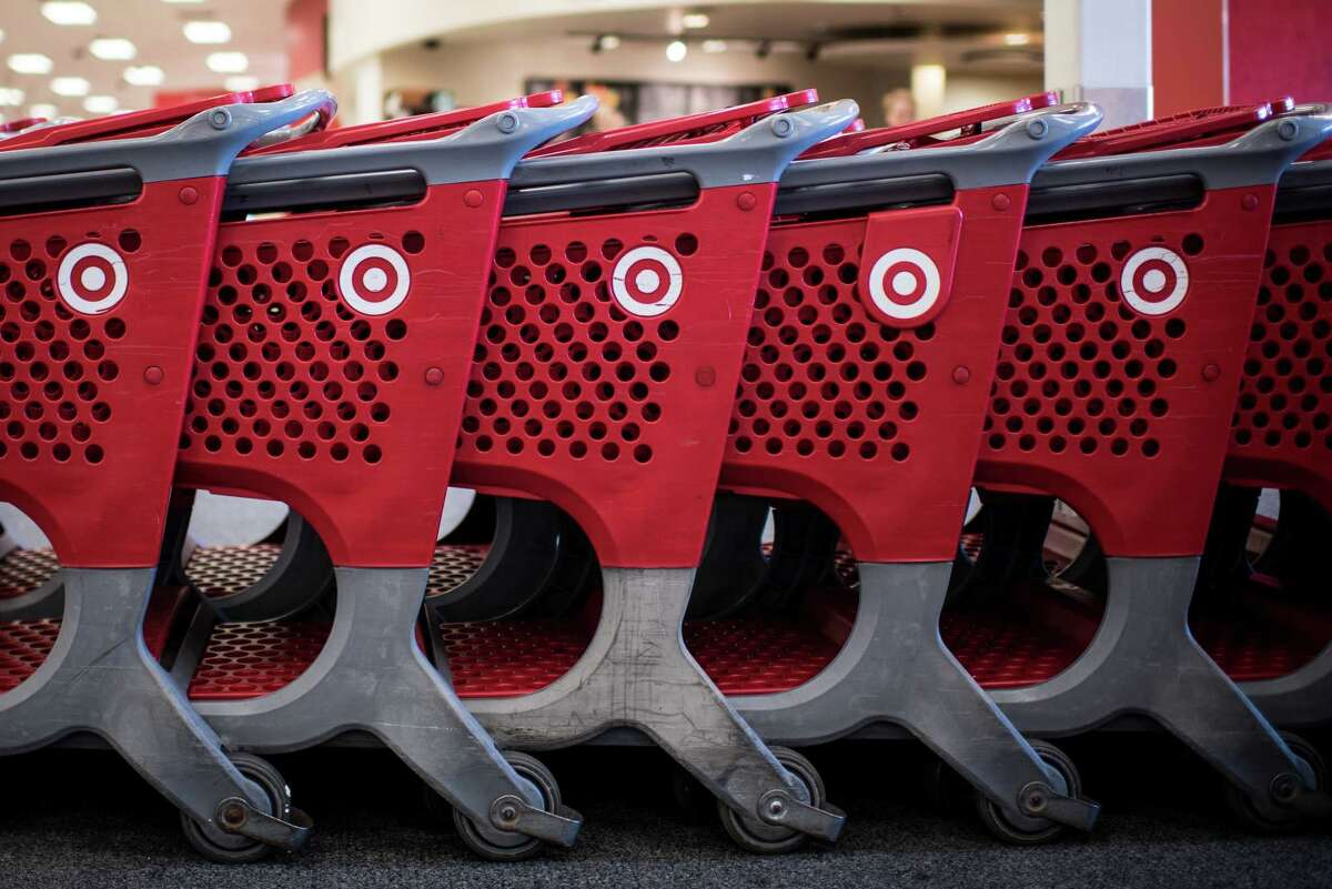 Target shopping carts sit inside a company store in Chicago on May 16, 2016. MUST CREDIT: Bloomberg photo by Christopher Dilts.