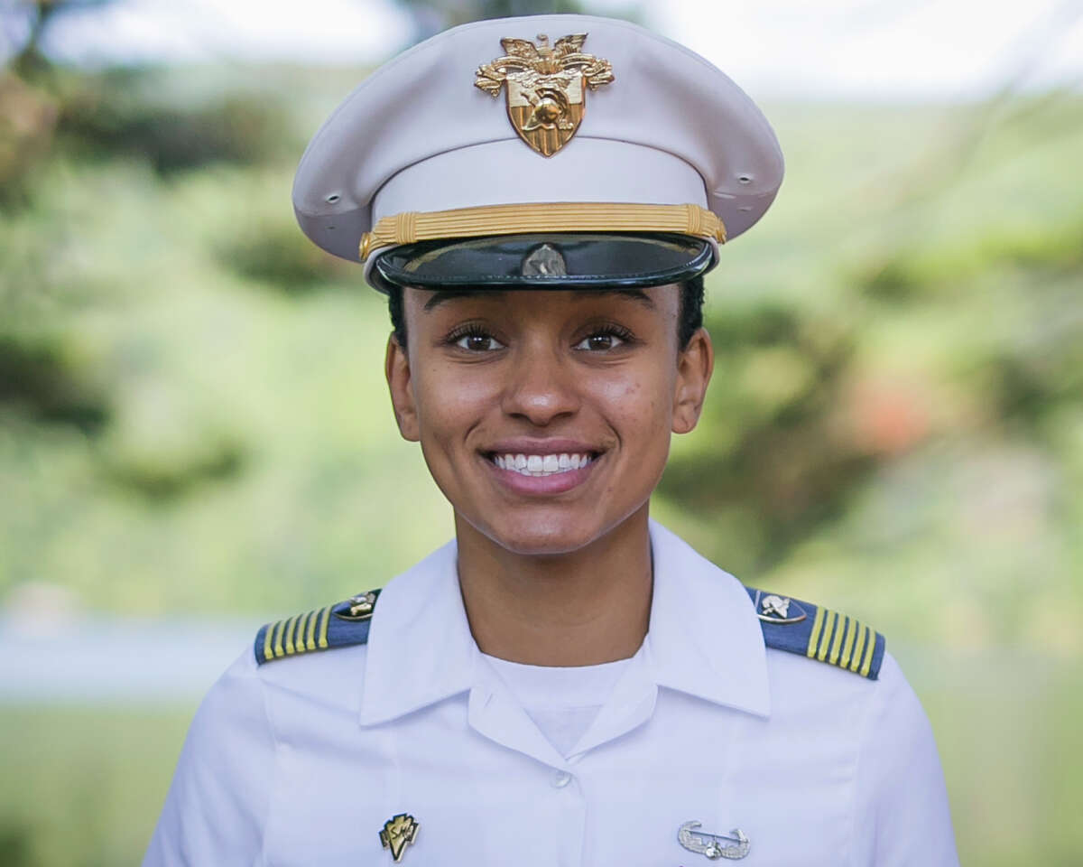In this Aug. 3, 2017, image provided by the U.S. Army, West Point Cadet Simone Askew poses for a photo. Askew is making history as the first black woman to lead the Long Grey Line at the U.S. Military Academy. She will be responsible for the overall performance of the roughly 4,400 cadets at West Point. (Austin Lachance/U.S. Army via AP) ORG XMIT: NYR501