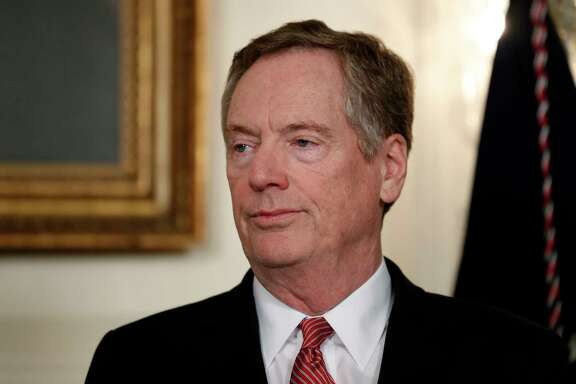 Ambassador to China Robert Lighthizer stands in the Diplomatic Reception Room of the White House in Washington, Monday, Aug. 14, 2017, during an event for President Donald Trump to sign a memorandum calling for a trade investigation of China. (AP Photo/Alex Brandon)