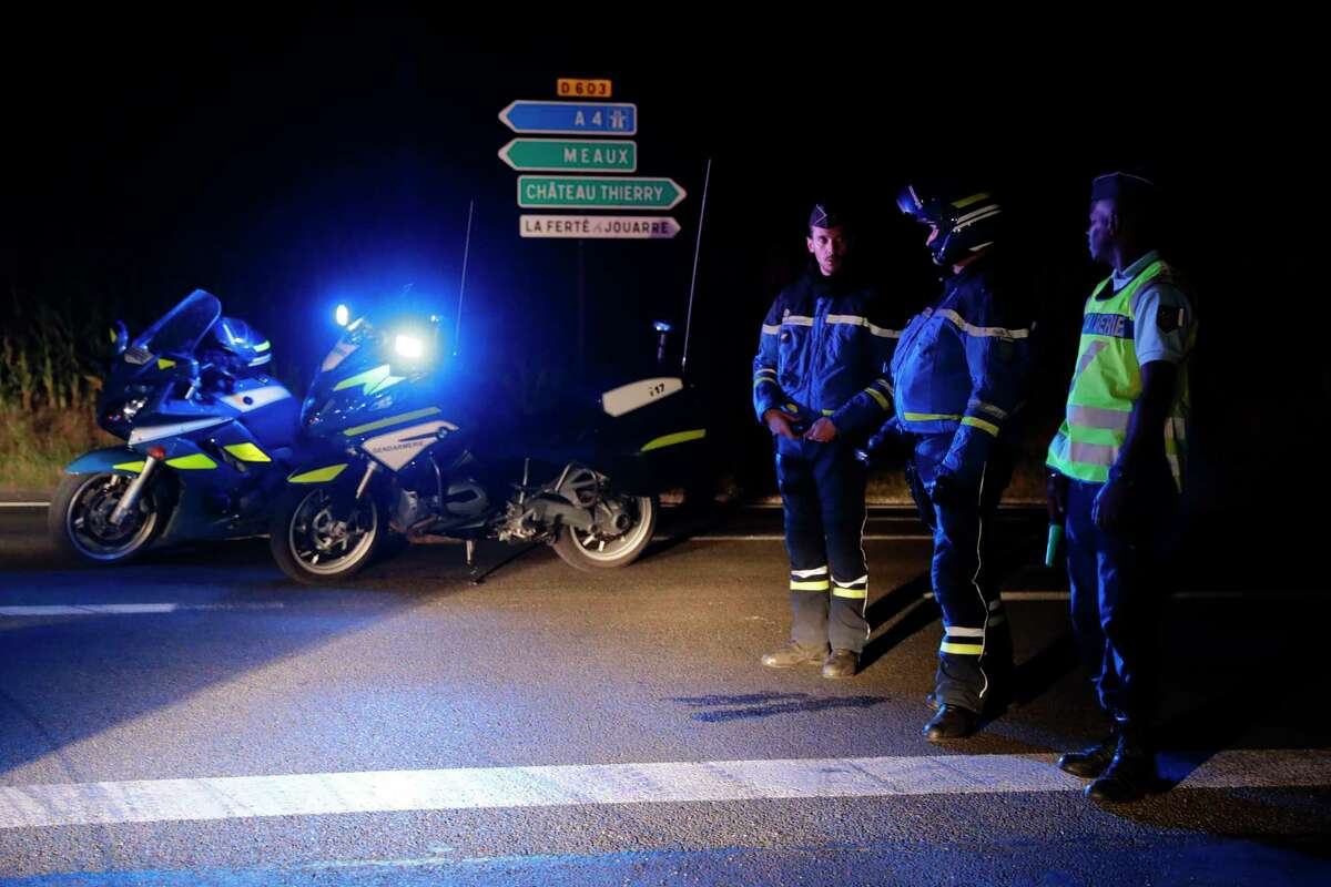 Police block a road near the site where man smashed a car into a pizza restaurant in Sept-Sorts, 55km east of Paris, on August 14, 2017, killing a 13-year-old girl and seriously injuring four. Investigators said the young driver had tried to commit suicide and the incident was not terror-related. The man, who was arrested, said