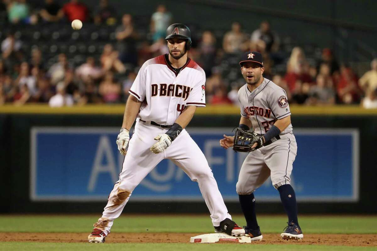 PHOENIX, AZ - AUGUST 14: Paul Goldschmidt #44 of the Arizona Diamondbacks stands on second base ahead of infielder Jose Altuve #27 of the Houston Astros after hitting a double during the sixth inning of the MLB game at Chase Field on August 14, 2017 in Phoenix, Arizona.