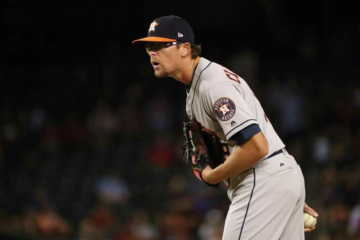 PHOENIX, AZ - AUGUST 14:  Relief pitcher Tyler Clippard #19 of the Houston Astros pitches against the Arizona Diamondbacks during the eighth inning of the MLB game at Chase Field on August 14, 2017 in Phoenix, Arizona. The Diamondbacks defeated the Astros 2-0.