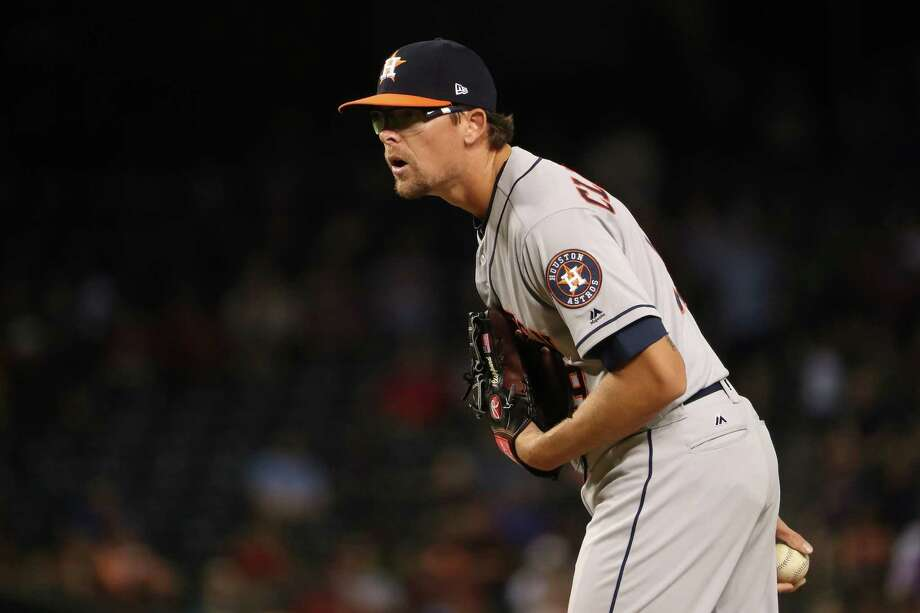 PHOENIX, AZ - AUGUST 14:  Relief pitcher Tyler Clippard #19 of the Houston Astros pitches against the Arizona Diamondbacks during the eighth inning of the MLB game at Chase Field on August 14, 2017 in Phoenix, Arizona. The Diamondbacks defeated the Astros 2-0. Photo: Christian Petersen, Getty Images / 2017 Getty Images