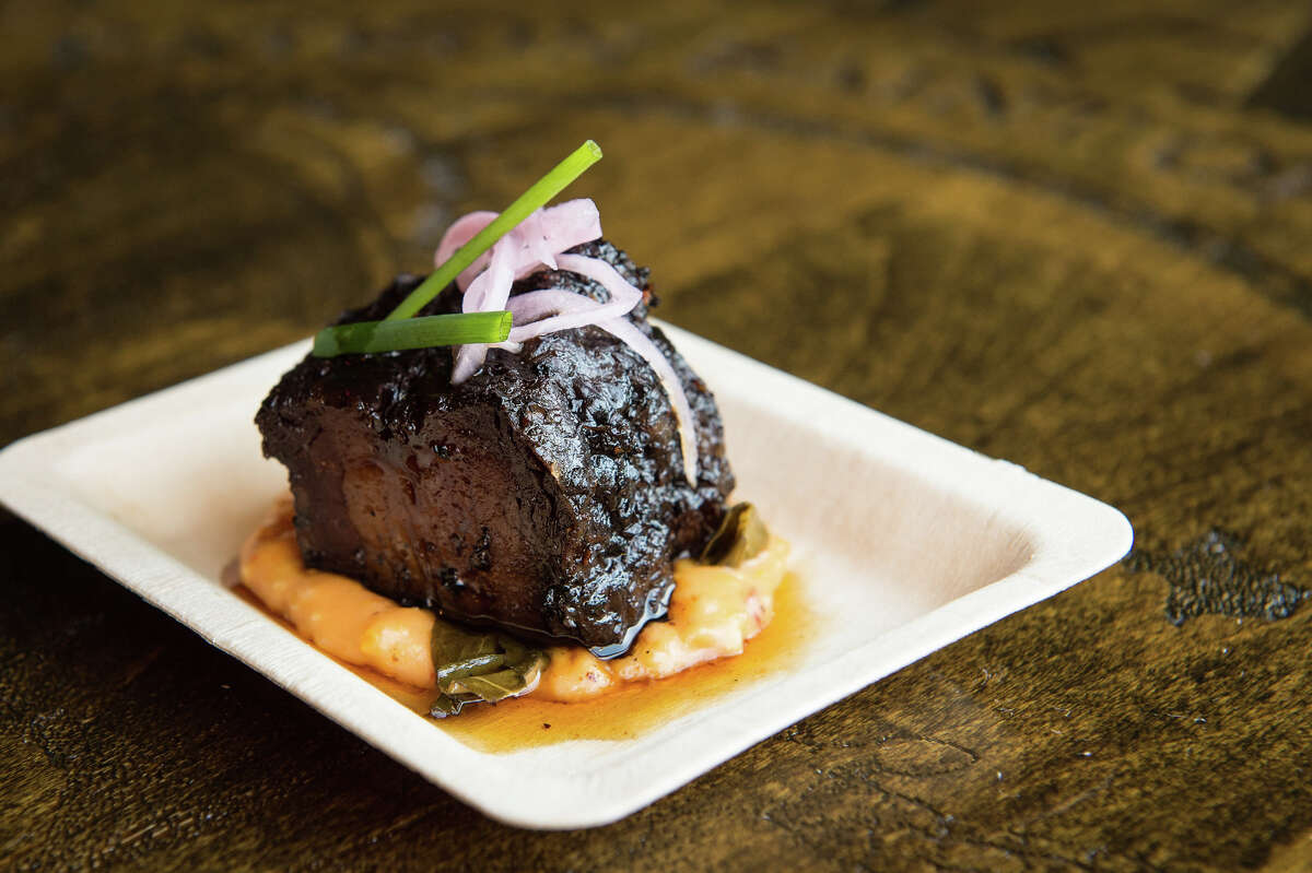 The 3rd annual Houston BBQ Throwdown will be held on Sept. 24 at Saint Arnold Brwing Company in Houston. The competition among pitmasters to create the next great barbecue dish is sponsored by the Houston Barbecue Festival and Saint Arnold. Shown: Feges BBQ entry: Beef Belly Burnt Ends with Pimento Cheese Grits, Braised Greens, Bourbon Cane Syrup, Pickled Red Onions and Chives. It won the People's Choice award.