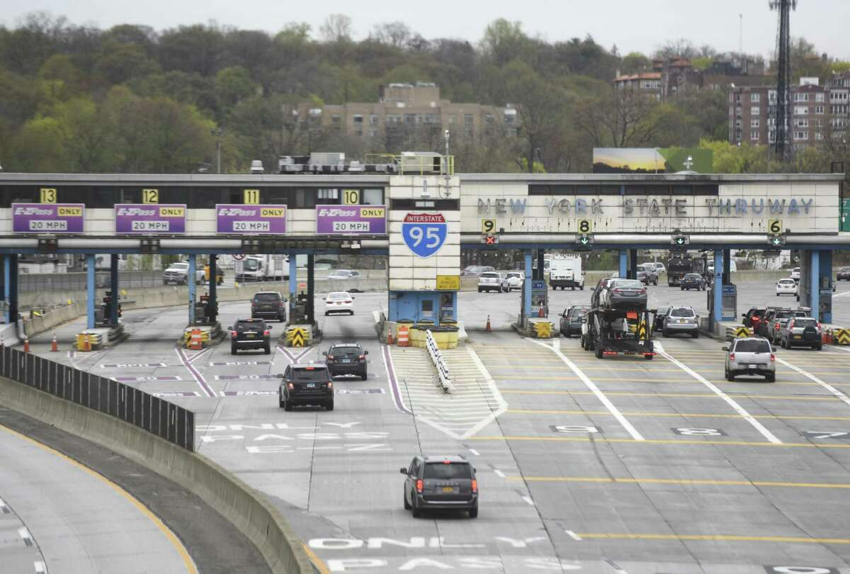 Cars pass through the New England Thruway toll plaza on the stretch of I-95 between New Rochelle and Larchmont, N.Y.