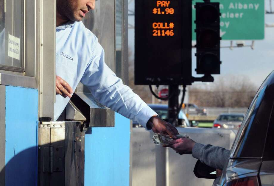 A New York State Thruway Authority toll collector collects the fee from a driver. Photo: Michael P. Farrell / Albany Times Union / 00030042A