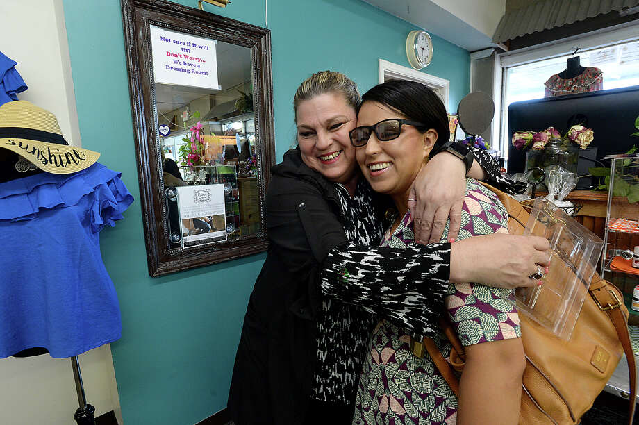"Letha Ruiz, store manager at The Rustic Door, hugs Rocio Toon, who said ""I feel good. I feel so pretty"" after getting a make-over from Ruiz at the shop Thursday. The management position is her primary source of income, but just one of several jobs. She also is a representative and saleswoman with Mary Kay Cosmetics, and tutors students and adults in learning Spanish. Photo taken Thursday, August 10, 2017 Kim Brent/The Enterprise Photo: Kim Brent / BEN"
