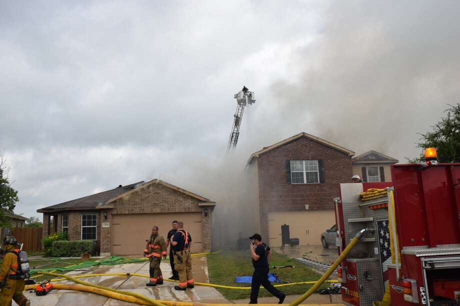 Two West Bexar County residents are being hailed as heroes after they broke into a burning home and saved a neighbors dog and notified another family that their home was on fire, possibly saving their lives. Photo: Caleb Downs / San Antonio Express-News