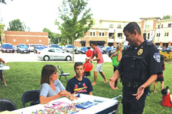 "To help build relationships between local law enforcement and the community, state Rep. Katie Stuart, D-Edwardsville, participated in National Night Out last week. ""This annual event is one opportunity for the community to come out and show our support for local police who sacrifice every day to keep our neighborhoods safe,"" Stuart said. ""Law enforcement and our men and women in blue are critical to our community. It's why I am sponsoring House Bill 778 to classify crimes against our officers as hate crimes. I understand how important it is that we have a responsibility to defend those who keep our families and our communities safe."" National Night Out is a nationwide opportunity for local police to interact with their communities and foster relationships in order to make neighborhoods safer.  Stuart is sponsoring House Resolution 122 to encourage police departments throughout the state to create a community liaison police officer program to create and maintain positive relationships between the community and law enforcement."