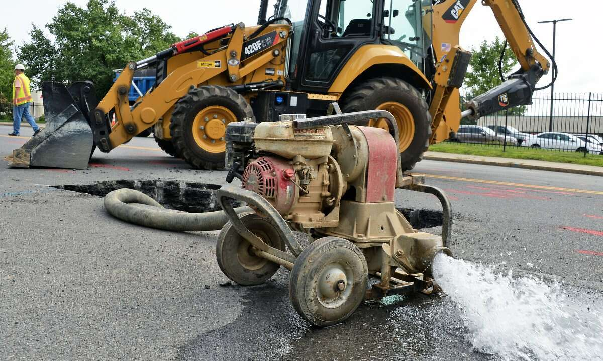 Crews work on a water main break that closed Broadway Tuesday for a two-block stretch between Livingston Avenue and North Lawrence Street in Albany.