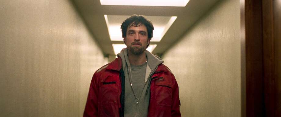 """In the crime drama """"Good Time,"""" lowlife criminal Connie (Robert Pattinson) tries to rescue his jailed brother after their bank robbery goes south.  Photo: A24 Photo: A24"""