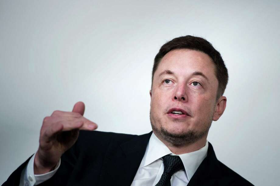 File photo of Elon Musk, CEO of SpaceX and Tesla. Musk left President Trump's advisory councils in June after Trump withdrew the U.S. from the Paris climate accord, saying climate change was real and that leaving the agreement wasn't good for Americans or the world. Photo: BRENDAN SMIALOWSKI /AFP /Getty Images / AFP or licensors