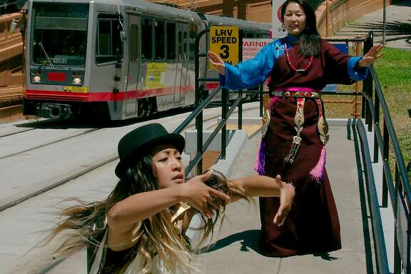 Sammay Dizon of Embodiment Project, left, and Tsering Wangmo of Chaksam-Pa perform in San Francisco Trolley Dances.   Photo: Andy Mogg