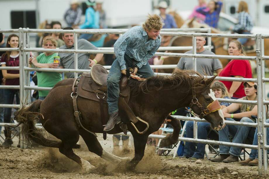 Josh Wilcox competes in steer riding during a rodeo on Monday, August 14, 2017 at the Midland County Fairgrounds. Photo: (Katy Kildee/kkildee@mdn.net)