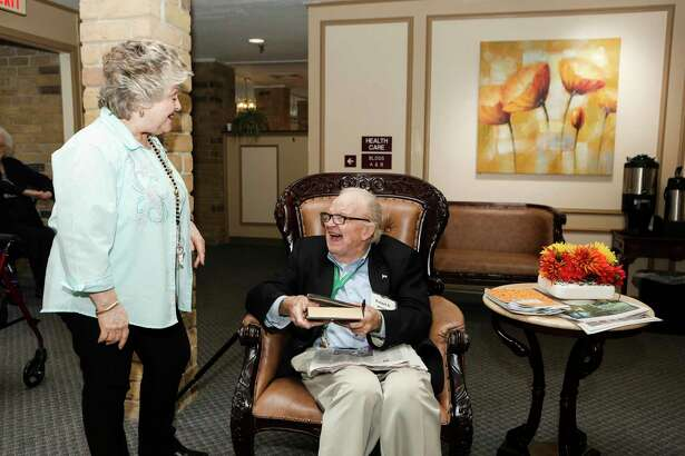 Monitoring residents' health needs and concerns is a priority at Treemont Retirement Community. Resident Bob Hinsley is shown during a visit with activities director Aimee Dubuisson.