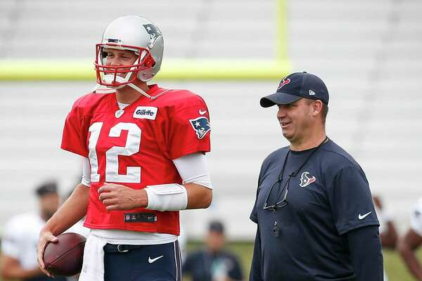 New England Patriots quarterback Tom Brady (12) and Houston Texans head coach Bill O'Brien talks during a joint practice between the Texans and the Patriots at training camp at The Greenbrier on Tuesday, Aug. 15, 2017, in White Sulphur Springs, W.Va.