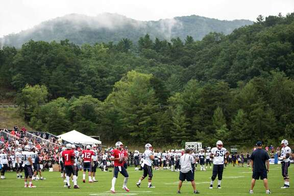 The New England Patriots work out during a joint practice between the Houston Texans and the Patriots at training camp at The Greenbrier on Tuesday, Aug. 15, 2017, in White Sulphur Springs, W.Va.