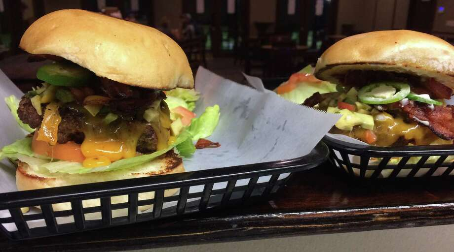 "The Rolling Oaks Golf & Grill at 5550 Mountain Vista Dr., reopened its kitchen, where it sells the ""Deluxe Burger"" with fries or a side salad for $11. Photo: Courtesy Photo"