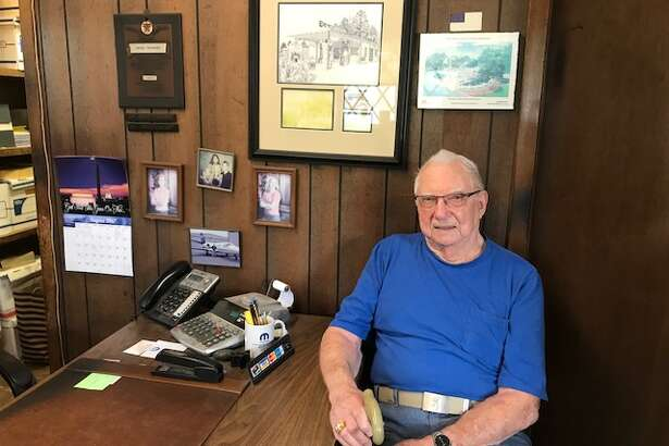Herbert Remmert takes a moment to reflect on the years of service        Remmert's Auto has provided to the Heights area. The family-owned shop is closing after 90 years in business.