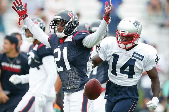 Houston Texans defensive back Robert Nelson, Jr., (21) reacts after breaking up a pass intended for New England Patriots wide receiver Brandin Cooks (14) during a joint practice between the Texans and the Patriots at training camp at The Greenbrier on Tuesday, Aug. 15, 2017, in White Sulphur Springs, W.Va.