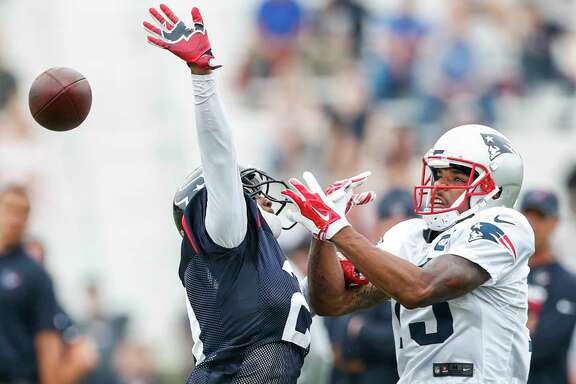 Houston Texans defensive back Robert Nelson, Jr., (21) breaks up a pass intended for New England Patriots wide receiver Devin Lucien (13) during a joint practice between the Texans and the Patriots at training camp at The Greenbrier on Tuesday, Aug. 15, 2017, in White Sulphur Springs, W.Va.