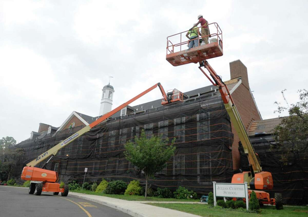 Construction continues at Julian Curtiss School in Greenwich, Conn. Tuesday, Aug. 15, 2017. The construction crew is restoring and renovating the front facade of the building.