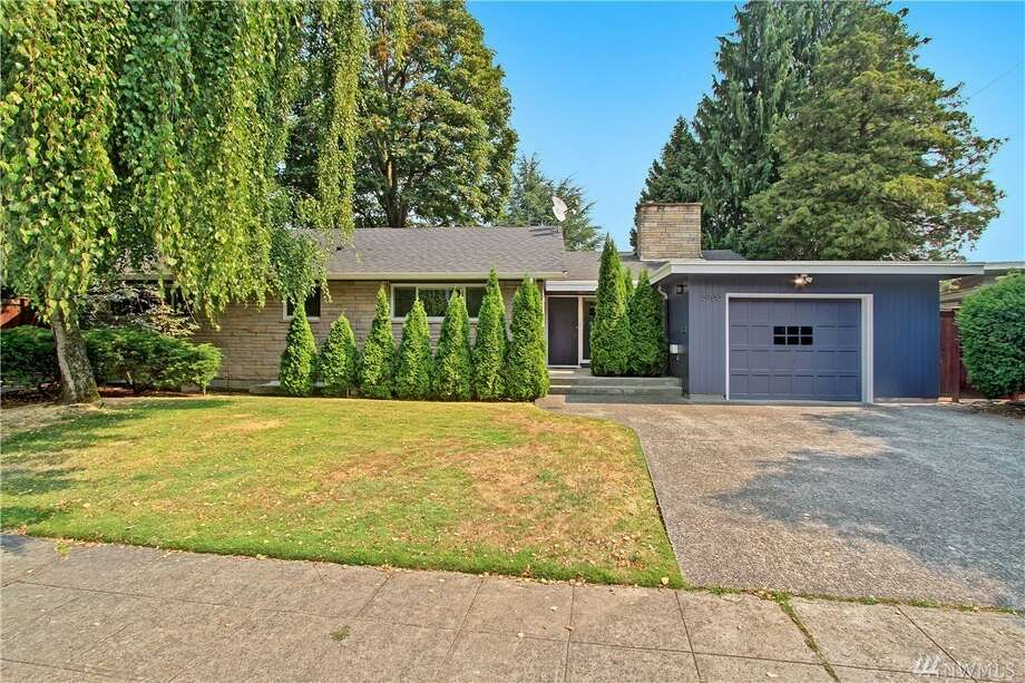 This updated, mid-century Modern home in Seward Park comes with Lake Washington views and a spacious floor plan. A newly-remodeled kitchen and opulent master bedroom with five-piece bathroom is a plus, but air conditioning and smart home features make this a win.5900 Wilson Ave. S., listed for $1,050,000. See the full listing here. Photo: Listing Provided Courtesy Of Elizabeth Azose, Windermere Real Estate/East