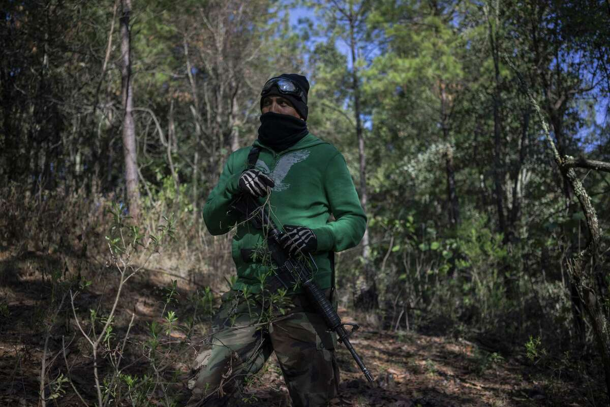 """A member of the Forest Keepers patrols in search of illegal loggers in Cheran, Michoacan State, Mexico, on June 9, 2017. """"Since the very beginning we have wanted three things: security, justice, and the restoration of our land,"""" Pedro Chavez Sanches says. """"Security was made possible thanks to our community patrol. The reconstitution of our land has been made possible because of the tree nursery. Justice, however, that is not that easy. The people of Cherán have lost loved ones, have family members that remain missing, they have pain, so justice is the hardest to reach, but we are progressing."""""""