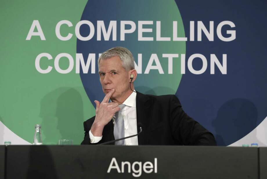 Praxair CEO Steve Angel ponders during press statements in Munich, Germany, Friday, June 2, 2017, after Germany's Linde AG and U.S. rival Praxair Inc. said they have agreed on a deal to merge the two businesses, creating a global leader in the field of industrial gas with a market value of US$70 billion. (AP Photo/Matthias Schrader) Photo: Matthias Schrader / Associated Press / Copyright 2017 The Associated Press. All rights reserved.