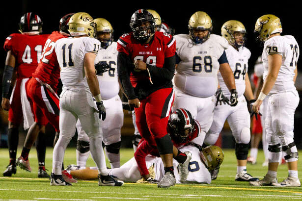 Westfield defensive tackle Keondre Coburn (99) celebrates a big play in a playoff game against Klein Collins. Coburn is generally ranked somewhere between 5th and 10th nationally at his position, and somewhere between 10th and 20th in terms of 'football players in the state of Texas.'