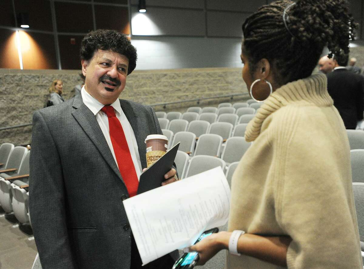 """Bridgeport Education Association President Gary Peluchette talks with Bridgeport Superintendent of Schools Aresta Johnson during the Commissioner's Annual Back-to-School Meeting with Superintendents at Maloney High School in Meriden, Conn. on Tuesday, August 15, 2017. A """"show of concern"""" press conference following the event urged legislators and the governor to agree on a state budget to avoid harms to public education."""