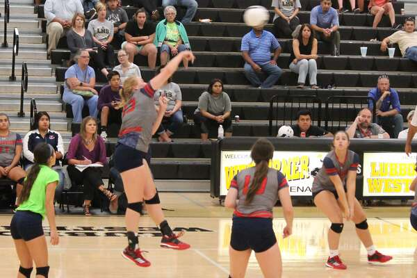 Plainview's Emily Collins hits the ball during a volleyball match at Lubbock High Monday night. Collins led the Lady Bulldogs with 24 kills in the contest, which Lubbock High won in five games.