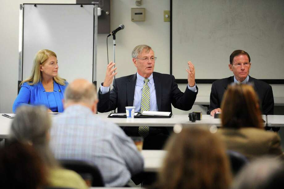 Connecticut Department of Transportation Commissioner James P. Redeker, center, speaks during a meeting with area officials regarding the future of the Northeast Corridor train line inside Government Center in downtown Stamford, Conn. on Tuesday, August 15, 2017. Also pictured are Darien First Selectman Jayme Stevenson, left, and Senator Richard Blumenthal (D- Conn.). Photo: Michael Cummo / Hearst Connecticut Media / Stamford Advocate