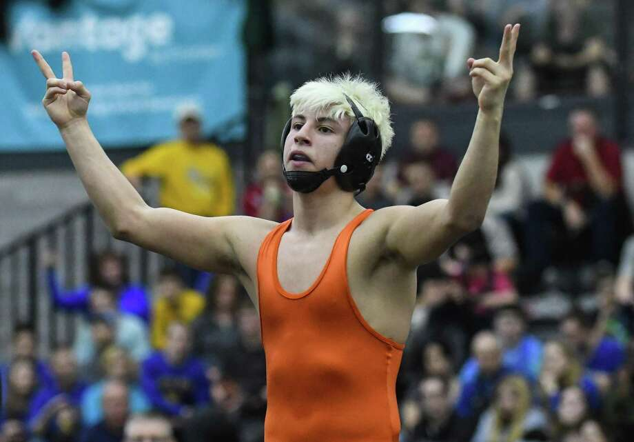 Danbury's Jakob Camacho celebrates his victory at120 pounds during the State Open Wrestling Championships at the Floyd Little Athlectic Center on February 25 in New Haven. Photo: Gregory Vasil / For Hearst Connecticut Media / Connecticut Post Freelance