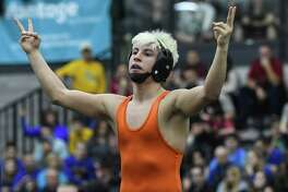 Danbury's Jakob Camacho celebrates his victory at120 pounds during the State Open Wrestling Championships at the Floyd Little Athlectic Center on February 25 in New Haven.