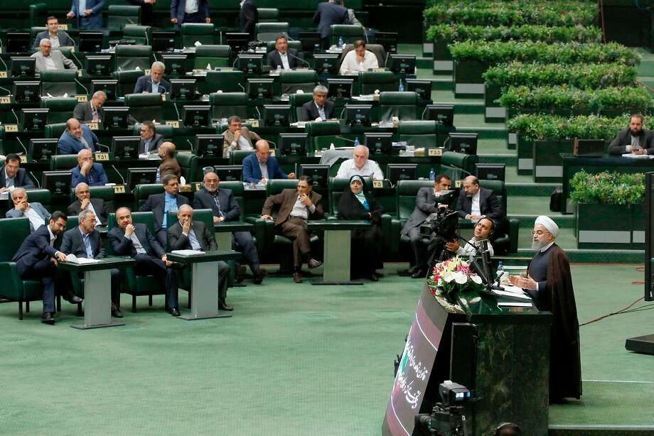 Iranian President Hassan Rouhani (right) addresses parliament about the nation's nuclear program. Photo: ATTA KENARE, AFP/Getty Images