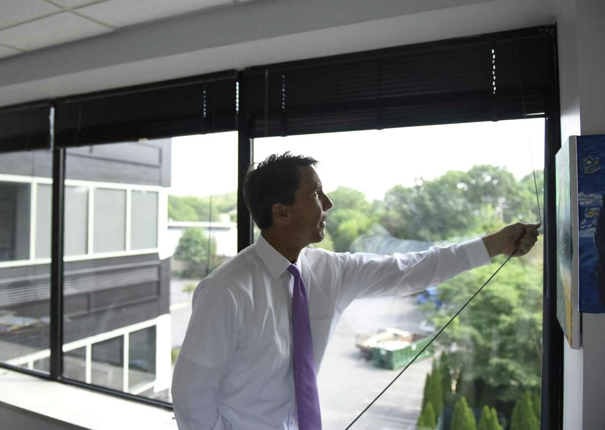 Greenwich United Way CEO David Rabin draws the blinds from his office in the United Way's new space at 500 West Putnam Ave. in Greenwich, Conn. Thursday, Aug. 10, 2017. Greenwich United Way moved out of its old space at 1 Lafayette Court in early July.