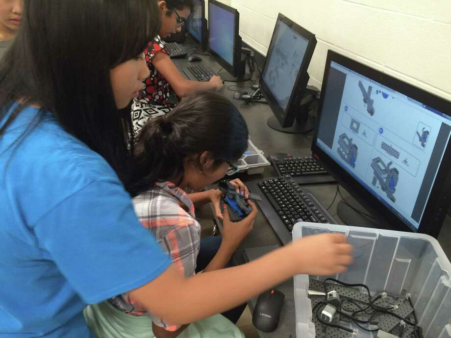 Students participate in a robotics club.