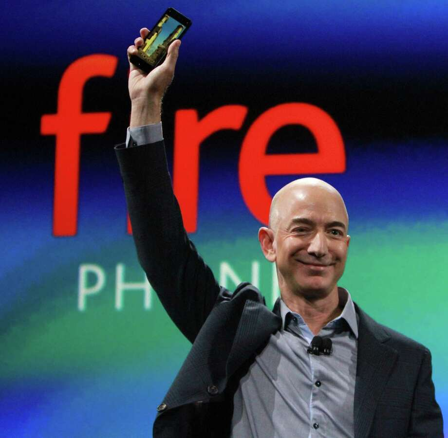 Amazon CEO Jeff Bezos attends an event in Seattle in a June 2014. Amazon.com Inc. is turning to the debt markets to fund the $13.7 billion acquisition of Whole Foods Market Inc. and power Bezos's planned conquest of the supermarket business. Photo: Ken Lambert /Seattle Times / Seattle Times