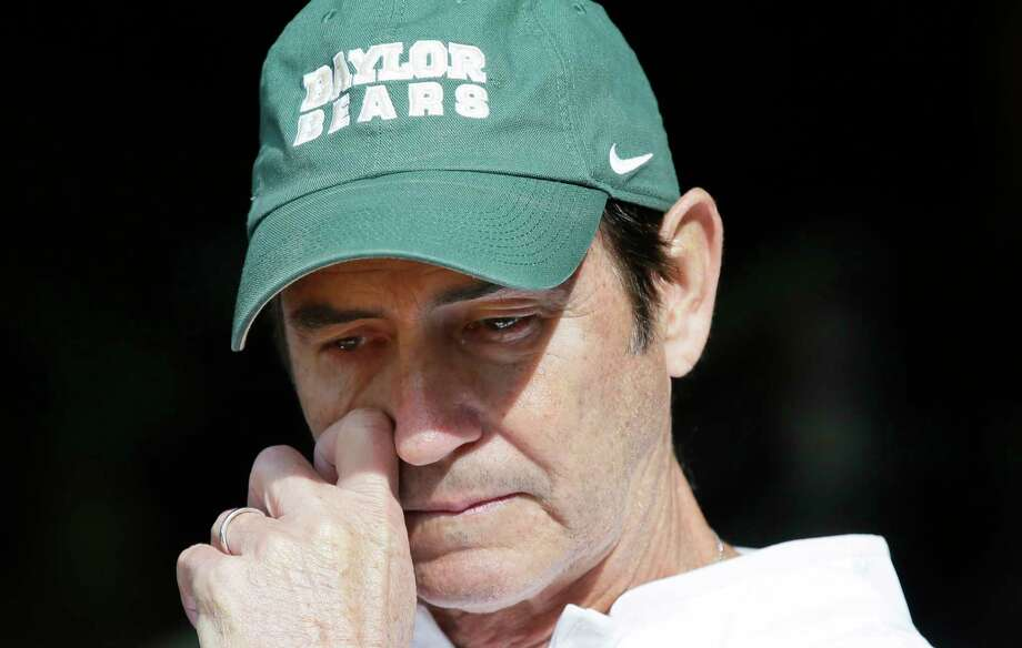 FILE - In this Dec. 5, 2015, file photo, Baylor head coach Art Briles gets emotional in the tunnel after his senior players were introduced before an NCAA college football game against Texas, in Waco, Texas. The NCAA board of governors has adopted a policy that requires sexual violence education for all college athletes, coaches and athletics administrators. Campus leaders such as athletic directors and school presidents will be required to attest that athletes, coaches and administrators have been educated on sexual violence each year. The move follows a number of high-profile assault cases, including Baylor.(AP Photo/LM Otero, File) Photo: LM Otero, STF / Copyright 2017 The Associated Press. All rights reserved.