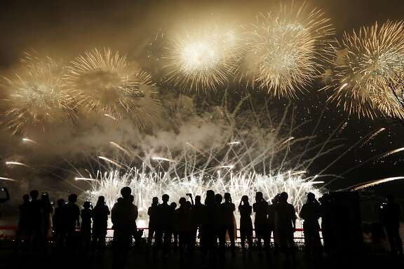 CHUNCHEON, SOUTH KOREA - JULY 22:  People watch fireworks during the ceremony marking the 200 days to go to the PyeongChang Winter Olympic Games on July 22, 2017 in Chuncheon, South Korea.  (Photo by Woohae Cho/Getty Images)