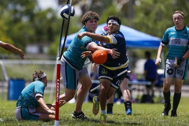 Washington Admirals chaser Raul Natera scores on Detroit Innovators beater Jack Slater during the Major League Quidditch national tournament  in League City.