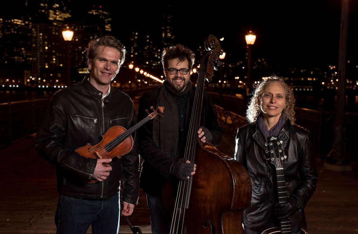 """The San Francisco String Trio, (from left to right) violinist Mads Tolling, bassist Jeff Denson and guitarist Mimi Fox, celebrate the release of their first recording, """"May I Introduce to You,"""" their take on the Beatles' classic """"Sgt. Pepper's Lonely Hearts Club Band,"""" Sept. 8 at Freight & Salvage."""