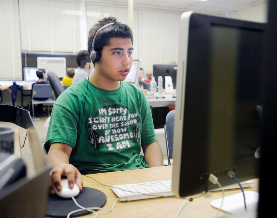 Eastern MIddle School sixth-grader Alan Jaramillo, 12, works on a computer at the school, Thursday afternoon, June 17, 2010. Photo: Bob Luckey / Greenwich Time