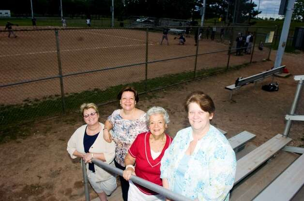 Former Park and Rec worker George Ritchie's family from left, his wife Cheryl, sister Pat Kellogg, mother Mildred S. Ritchie and sister Jeanne Lauer in Cummings Park June 16, 2010. Softball fields 1 & 2 will be named after Ritchie who passed away. Photo: Keelin Daly / Stamford Advocate