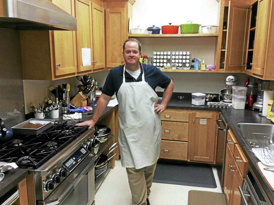 William Stewart, a Gateway Community College graduate, is a test kitchen assistant at Fine Cooking magazine. Photo: Stephen Fries/Special To The Register