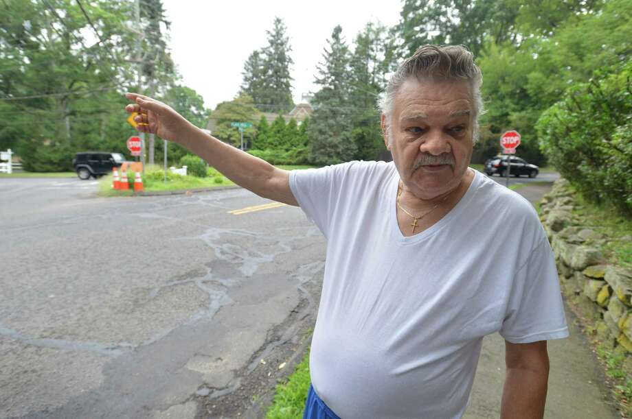 Highland Avenue resident Leo Motyke talks about the intersection at Flax Hill Road near his home on Tuesday. The intersection is to be recononstructed by the city the state DOT. Photo: Alex Von Kleydorff / Hearst Connecticut Media / Norwalk Hour